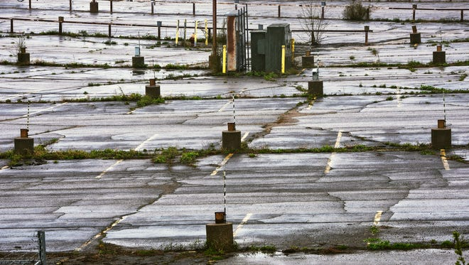 Rain falls on the former employee parking lot at the former Verso paper mill site Monday, May 1, in Sartell.