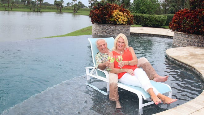 """Joey Miller, left, and Gail Flesche relax in their own little """"Margaritaville"""" before guests arrive for the annual Silver Bells Holiday Home Tour on Dec. 2."""