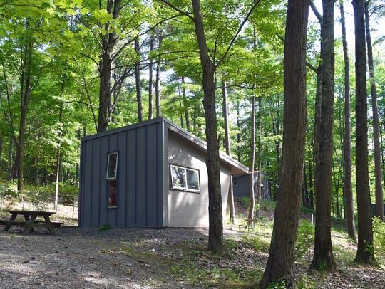 A newly constructed cabin at Buttermilk Falls State