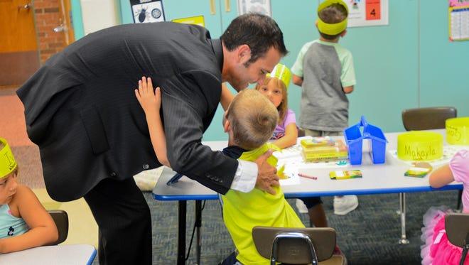 Algonac Community Schools Superintendent John Strycker greets students at Millside Elementary School.