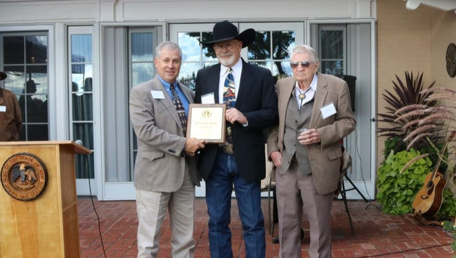 New Mexico Agriculture Secretary Jeff Witte, left, presented the 2015 Rounders Award to painter Gary Morton (center) for his artistic contributions to western culture.  At right is Max Evans, after whose seminal western novel, The Rounders, the award is named.