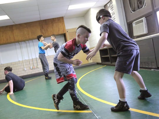 Eight-year-old Phoenix Hunter, left, practices his