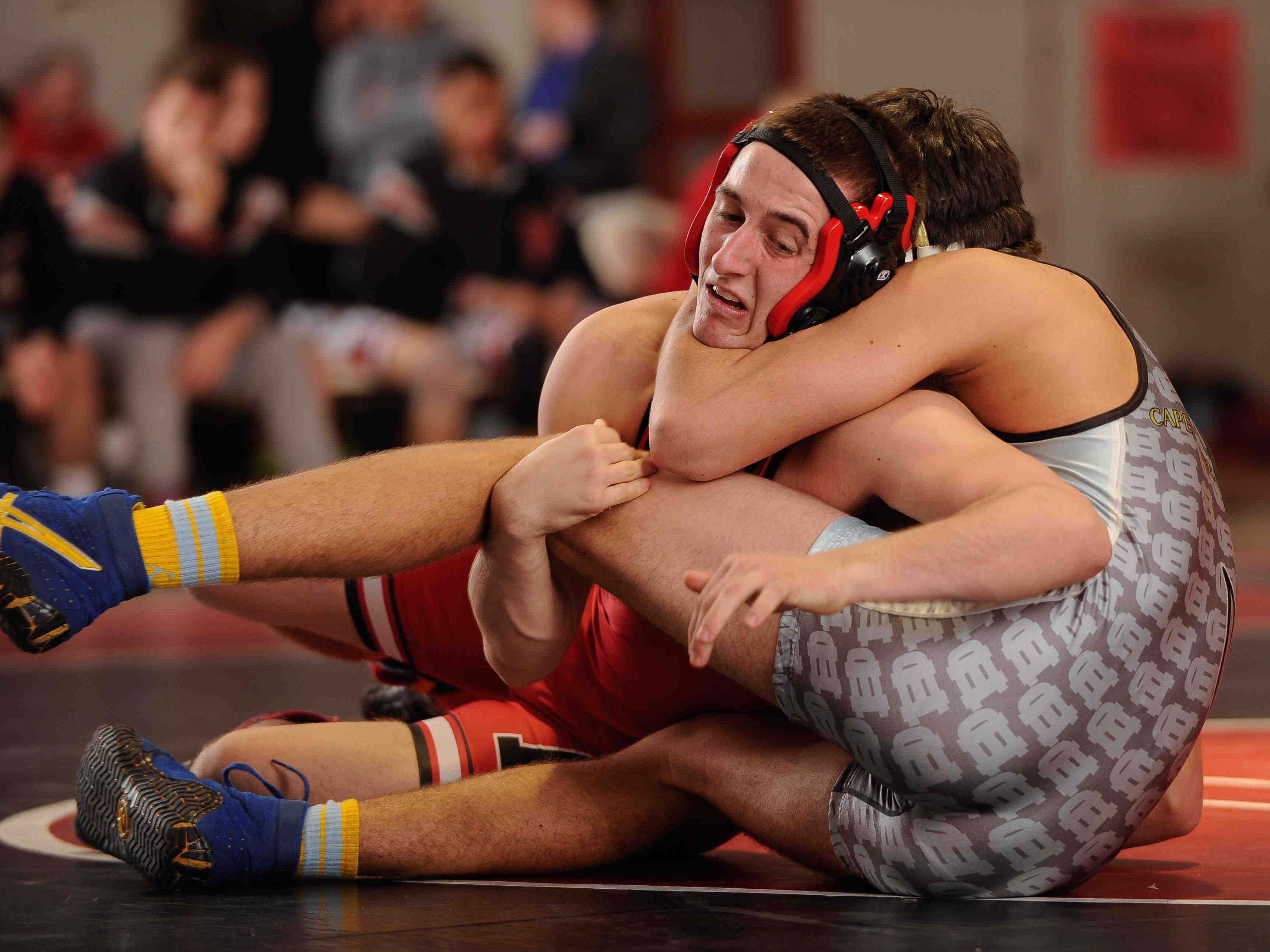 Polytech's Austin Rains (left) being tied up by Cape Henlopen's Brock Maloomian in the 182 pound class.