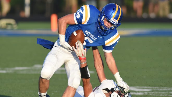 Maysville's Evan Brown stiff arms Crooksville's Trey White to the ground while maintaining possession of the ball during the Panthers' 35-23 victory over against Crooksville earlier this season. The Panthers host Sheridan in a key Muskingum Valley League game tonight.