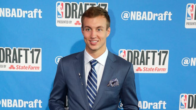 Duke's Luke Kennard poses for photos on the red carpet before the NBA basketball draft, Thursday, June 22, 2017, in New York.