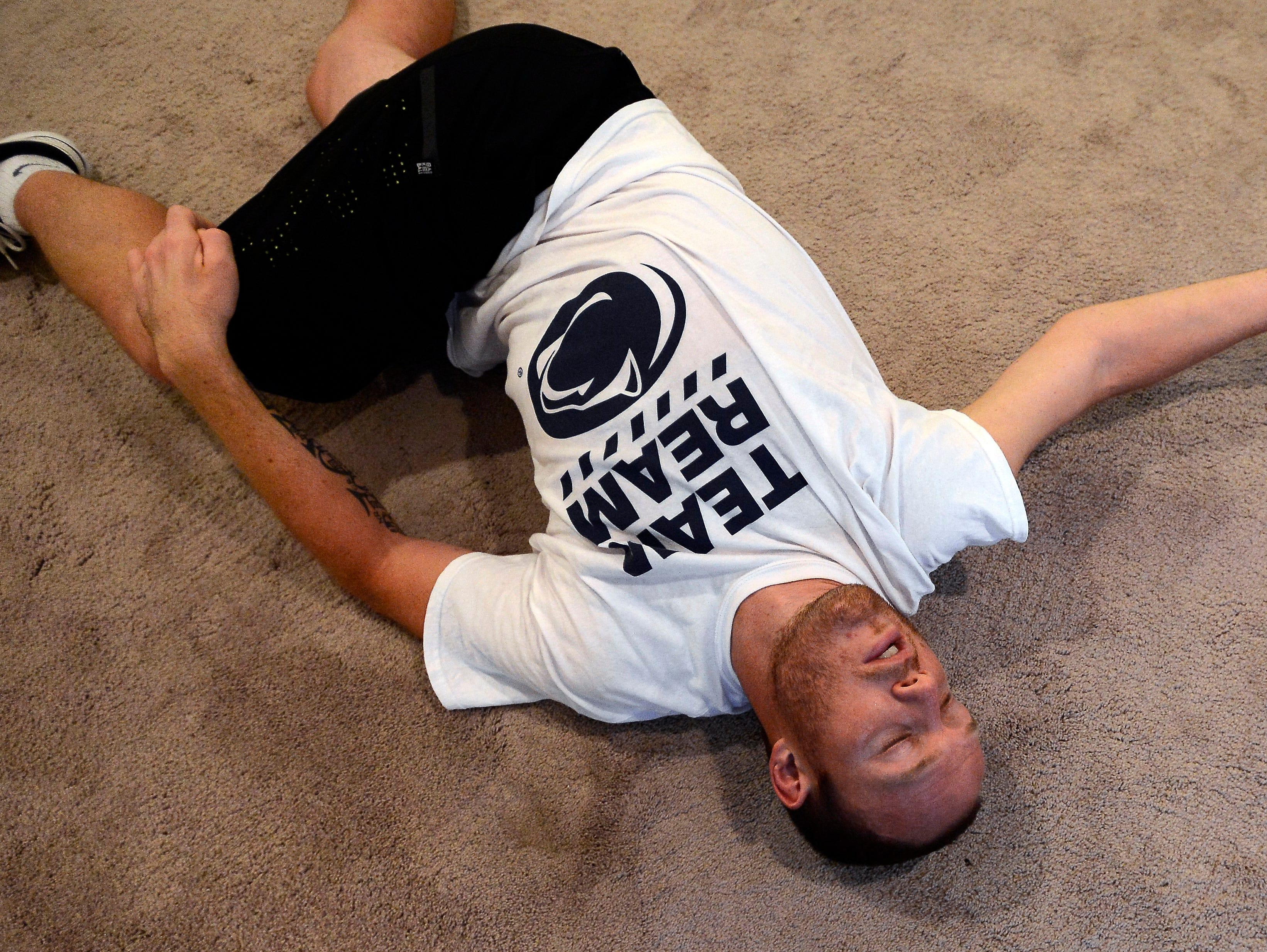 Tim Shaw stretches at the end of his workout on Tuesday in Nashville Tenn.