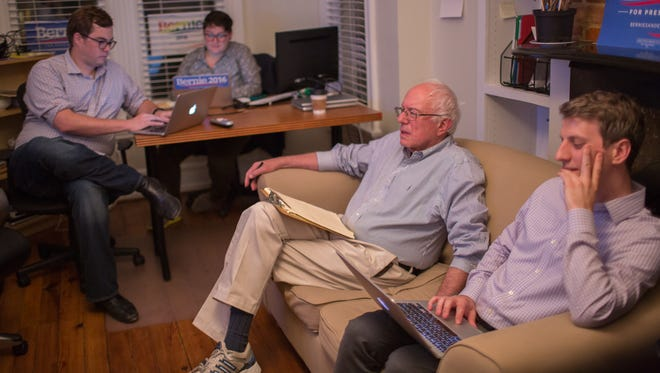 From left, Revolution Messaging's Michael Whitney and Carla Aronsohn, Sen. Bernie Sanders and Sanders' digital director Kenneth Pennington watch the GOP debate on Aug. 6, 2015, trolling it on Twitter.