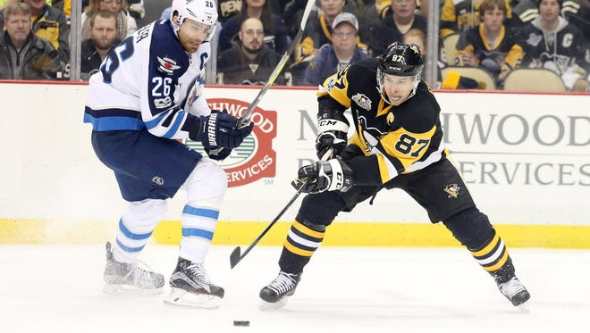 Sidney Crosby collected his 1,000th career point on an assist against the Winnipeg Jets.