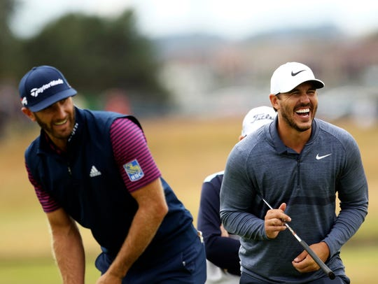 Dustin Johnson, left and Brooks Koepka share a joke