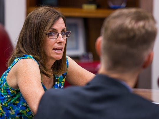 Rep. Martha McSally, R-Ariz, meets with Terry Rozema, police chief of the Town of Marana, in her offices in Tucson on Aug. 21, 2017.