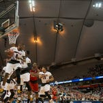 U of L's Terry Rozier hauls in one of his 14rebounds against NC State.