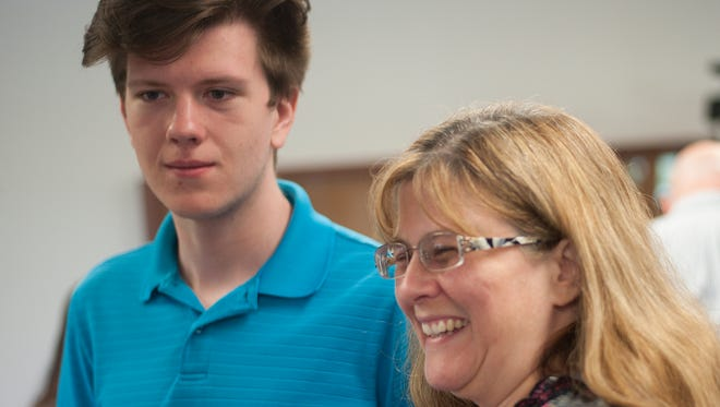 Millville Senior High School student Jacob Parliman, a Top 10 career and technology student, already helps mom Vicky Parliman with her computer issues. The Parlimans were at a Kiwanis luncheon Thursday that honored Jacob and other students.