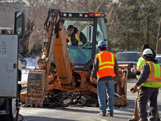 A water main break repair is made on Feb. 24 on Dukes Parkway East at North 8th Avenue in Manville, by workers from New Jersey American Water.