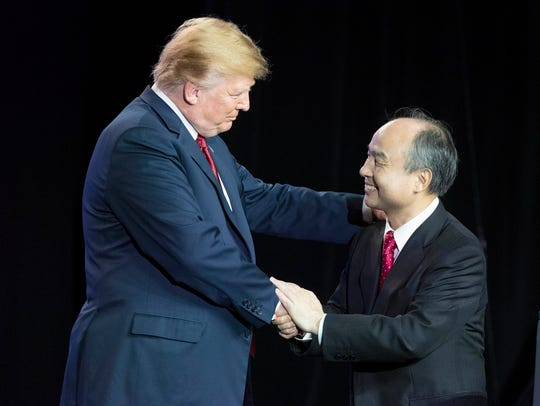 President Trump shakes hands with Softbank CEO Masayoshi