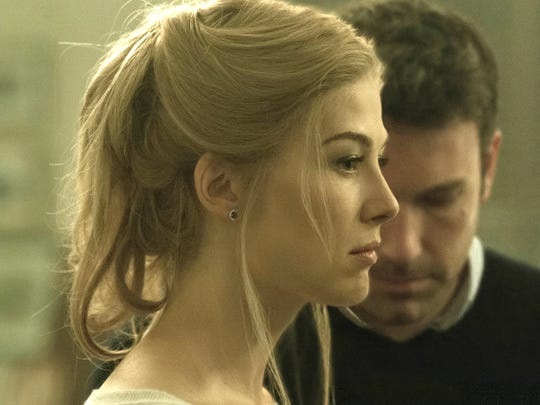 """In """"Gone Girl,"""" Rosamund Pike plays Amy Dunne, whose mysterious disappearance turns her husband Nick, played by Ben Affleck, into a possible murder suspect."""