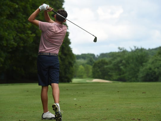 Jeffrey Peters of Hyde Park tees off during the second