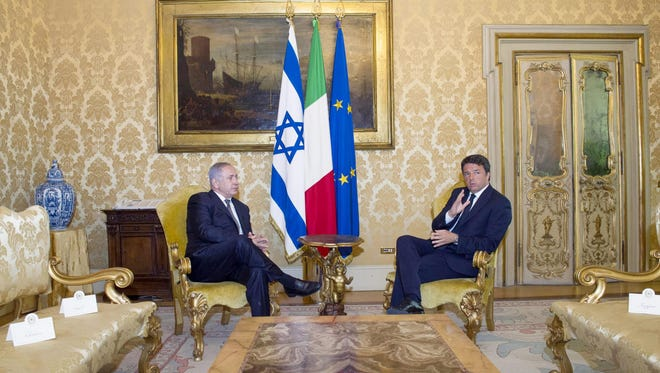A handout picture provided by the Chigi Palace Press Office on June 27, 2016, shows Italian Prime Minister, Matteo Renzi (right), meeting with the Prime Minister of Israel, Benjamin Netanyahu, at Chigi Palace in Rome, Italy.