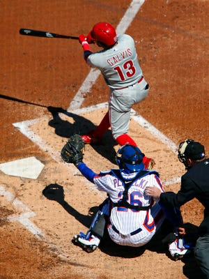 Phillies shortstop Freddy Galvis hits a sacrifice fly to left field scoring Philadelphia Phillies right fielder Peter Bourjos in the third inning Sunday at Citi Field.