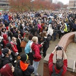 Members of the Ithaca College campus community gather for a protest Wednesday.