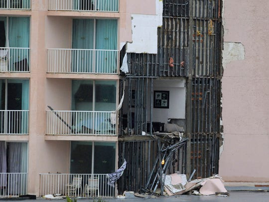 Hotel rooms are exposed after a wall broke away at the RIU hotel during the passage of Hurricane Matthew at Paradise Island in Nassau, Bahamas, Thursday, Oct. 6, 2016.