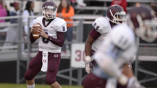 Rod Sanford/Lansing State Journal Quarterback Grant Klaver and his Okemos teammates would qualify for the playoffs by winning their final three games. Okemos quarterback Grant Klaver looks to pass against Everett  in Lansing Friday 9/12/2014.  (Lansing State Journal | Rod Sanford)