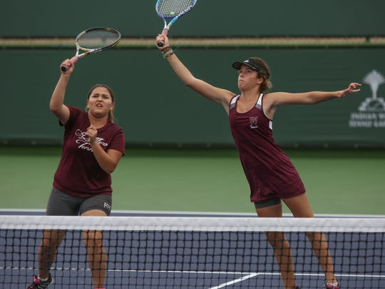 Zoe Kolytiris, right, and Karla Munoz play in the number one doubles match during the De Anza League Championship at the Indian Wells Tennis Garden, October 27, 2016.