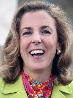 Katie McGinty addresses a reporter's question after casting her vote Tuesday, April 26, 2016  in Wayne, Pa. Former Congressman Joe Sestak looks to hold off McGinty, the party-endorsed candidate,  and win the Democratic nomination for U.S. Senate, setting up a rematch with the Republican incumbent Pat Toomey. (Photo/Jacqueline Larma)