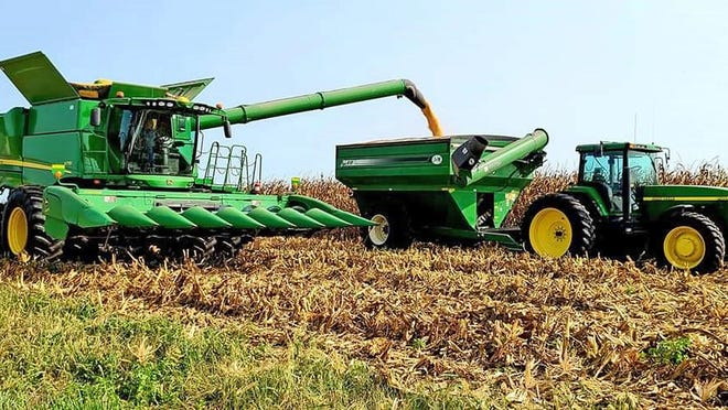 Daniel Wieland harvests corn Sept. 16. More farm vehicles will be on roadways as the harvest season picks up, so motorists are advised to use caution.
