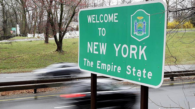 In a March 29 file photo, a sign welcomes motorists to New York on the border with Connecticut, near Rye Brook, N.Y.