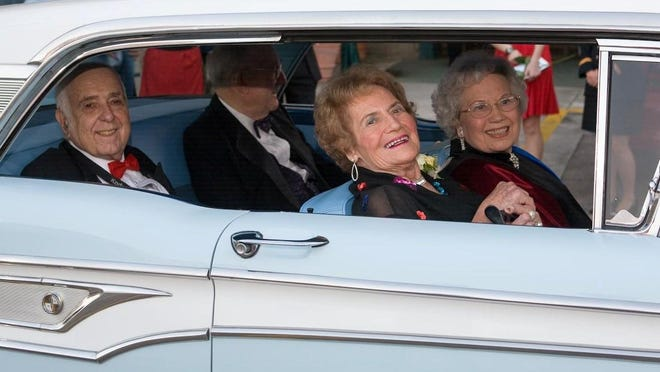 """Emily Remington (front passenger seat) arrives alongside Chris """"Eve"""" Sizemore at the Imperial Theatre for the 2008 Augusta showing of """"The Three Faces of Eve."""" The pair, along with Robert Symms (left) and Jim Davis, rode in a 1959 Edsel with a police escort to the Imperial."""