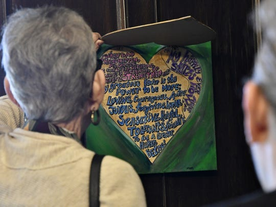 Corizon Lastimado: Healing the Wounded Heart art exhibit attendees view survivor artwork at the Rape Crisis Center on Wednesday morning.