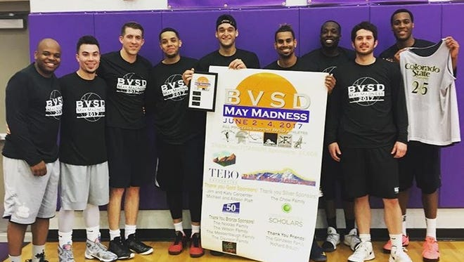 A team made up of some of the best CSU basketball players in recent history post for a picture Sunday after winning a benefit tournament in Boulder. Players, from left, are Terel Hughes, Kaipo Sabas, Pierce Hornung, Daniel Bejarano, J.J. Avila, Gian Clavell, Will Bell, Grant Hornung and Andy Ogide. All but Grant Hornung played college basketball for the Rams.