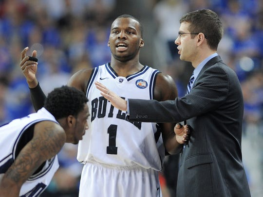 Butler's Shelvin Mack talks with coach Brad Stevens