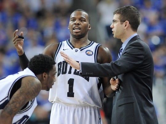 Butler's Shelvin Mack talks with coach Brad Stevens