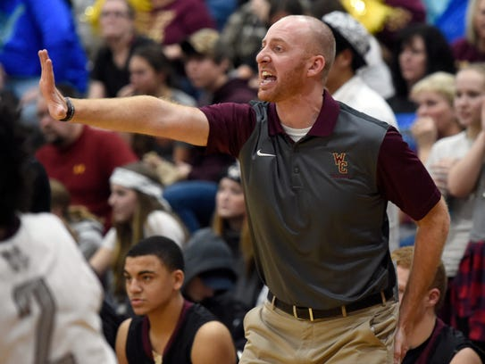 Webster County head coach Jon Newton shouts out instructions