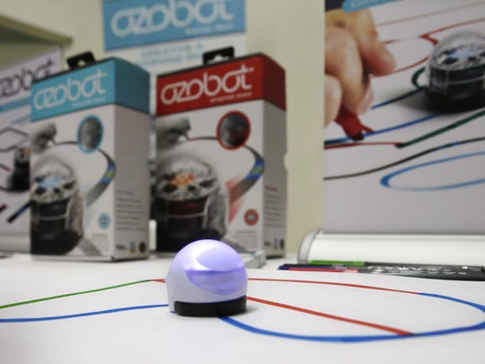 Kids as young as 7 can tell a pingpong ball-sized Ozobot robot to do things, such as go forward, backward, or spin around.