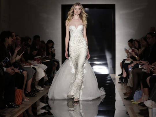 Reem Acra toyed with dress tops molded at the chest,