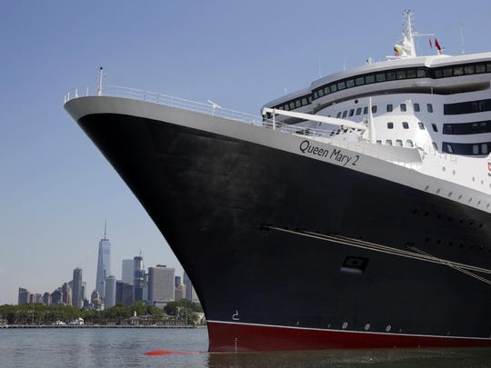 The New York City skyline appears behind the ocean liner Queen Mary 2 as she sits docked at her homeport at the Brooklyn Cruise Terminal in New York. The Cunard ship underwent $132-million of renovations that include, for its four-legged passengers, additional kennels, more play space and an owner's lounge.