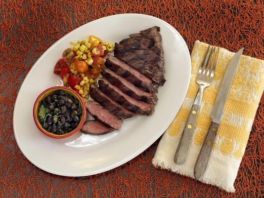 skirt steak,beer-braised black beans,corn salsa