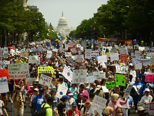 Marchers move from the U.S. Capitol to the White House on April 29 for the People's Climate Movement to protest President Trump's environmental policies and to demand a clean energy economy.