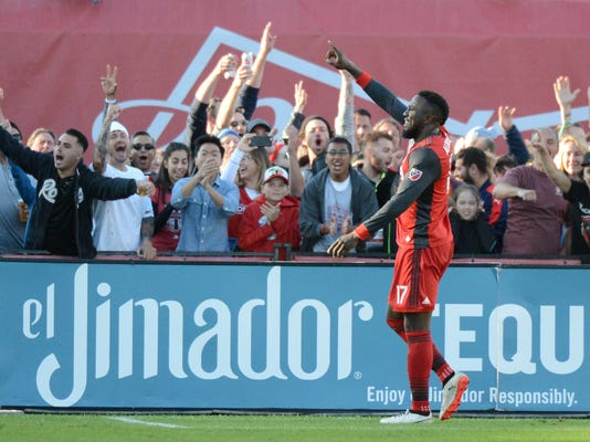 Toronto FC's Jozy Altidore motions to the crowd after scoring a goal during second-half MLS soccer match action in Toronto, Saturday, Sept. 9, 2016. (Jon Blacker/The Canadian Press via AP)