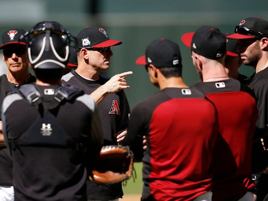 Arizona Diamondbacks manager Torey Lovullo, third from left, talks with his players during practice at Chase Field as the team gets ready for a National League wild-card playoff baseball game Monday, Oct. 2, 2017, in Phoenix. The Diamondbacks face the Colorado Rockies on Wednesday. (AP Photo/Ross D. Franklin)