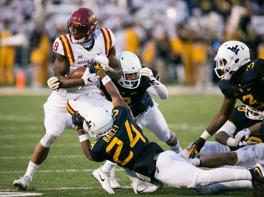 Iowa State wide receiver Hakeem Butler (18) is brought down by West Virginia's Hakeen Bailey (24) during the second half of an NCAA college football game in Morgantown, W.Va., on Saturday, Nov. 4, 2017. (AP Photo/Walter Scriptunas II)