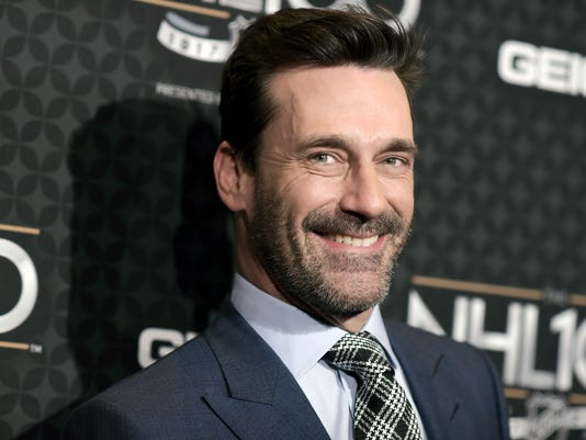 """FILE - In this Jan. 27, 2017, file photo, Jon Hamm arrives at the The NHL100 Gala held at the Microsoft Theater on Friday, Jan. 27, 2017, in Los Angeles.  The record-breaking career of hockey's greatest player one highlight of """"The NHL: 100 Years"""" documentary that airs Sunday, Nov. 26, a century to the date of league's founding on Nov. 26, 1917. After narrowing down its top 100 players, its greatest teams and best moments and going outdoors during the yearlong commemoration, the NHL is letting  Hamm narrate its growth from fledgling league on life support to 31 franchises today.(Photo by Richard Shotwell/Invision/AP)"""