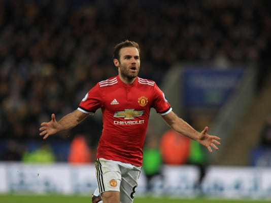 Manchester United's Juan Mata celebrates scoring his side's second goal of the game during their English Premier League soccer match against Leicester City at the King Power Stadium, Leicester, England, Saturday, Dec. 23, 2017. (Mike Egerton/PA via AP)