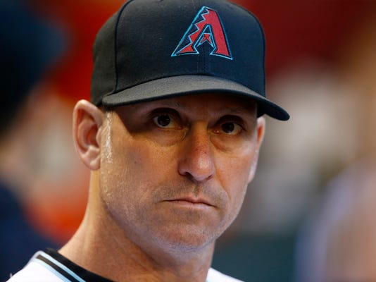 FILE - In this June 9, 2017, file photo, Arizona Diamondbacks' Torey Lovullo pauses in the dugout prior to a baseball game against the Milwaukee Brewers, in Phoenix. The Diamondbacks were one of baseball's big surprises a year ago. The surprise this year would be if they don't keep winning. ``Last year we kind of snuck up on people and had to earn their respect,'' said Lovullo, the National League manager of the year in his first season in the desert. (AP Photo/Ross D. Franklin, File)
