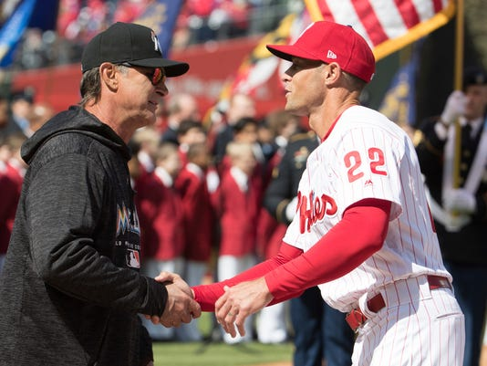 Miami Marlins manager Don Mattingly, left, shakes hands with Philadelphia Phillies manager Gabe Kapler, right, prior to the first inning of a baseball game, Thursday, April 5, 2018, in Philadelphia. (AP Photo/Chris Szagola)