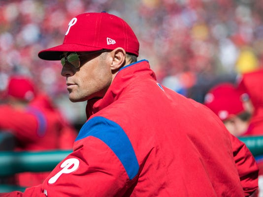 Philadelphia Phillies manager Gabe Kapler looks on from the dugout during the first inning of a baseball game against the Miami Marlins, Thursday, April 5, 2018, in Philadelphia. (AP Photo/Chris Szagola)