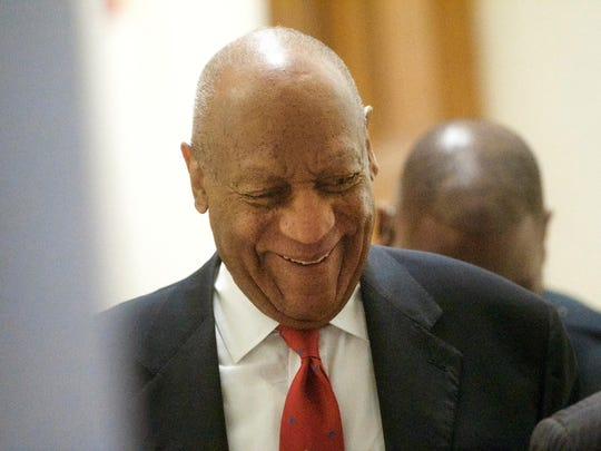 Actor and comedian Bill Cosby walks through the Montgomery