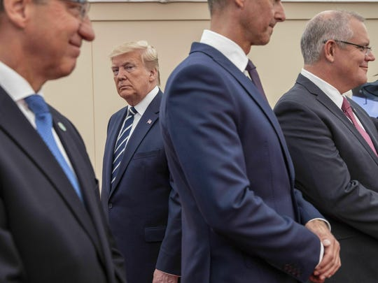 President Donald Trump, second left, attends the National Commemorative Event commemorating the 75th anniversary of D-Day, in Portsmouth, England, Wednesday June 5, 2019. (Jack Hill/Pool via AP)